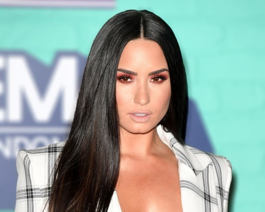 demi-lovato-removes-make-up-in-vogue-video-web-lead-1