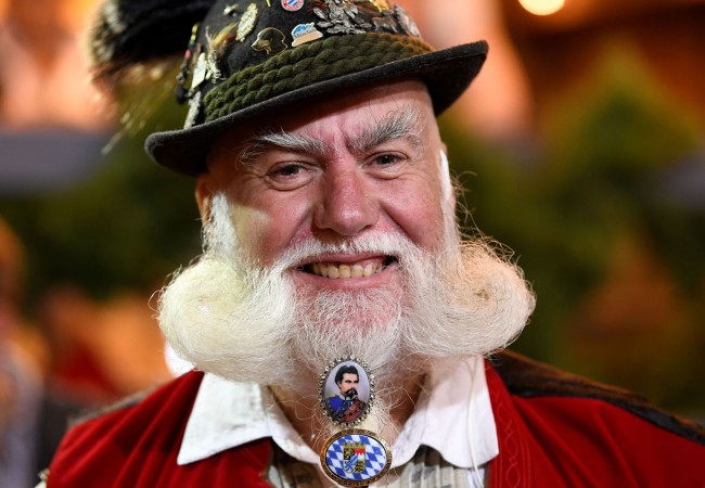 A visitor poses for a picture at the opening day of the 185th Oktoberfest in Munich